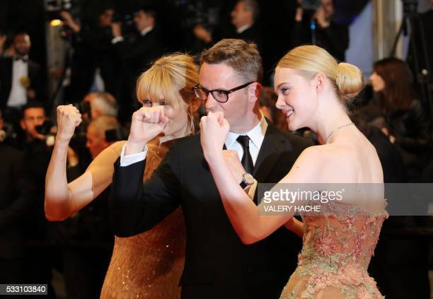 Danish director Nicolas Winding Refn poses with his wife Liv Corfixen and US actress Elle Fanning as they arrive on May 20, 2016 for the screening of...