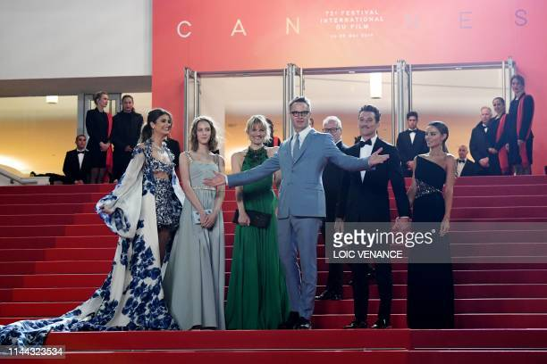 Danish director Nicolas Winding Refn poses with US model Taylor Hill , his wife Liv Corfixen and daughter Lola and US actor Miles Teller and his...