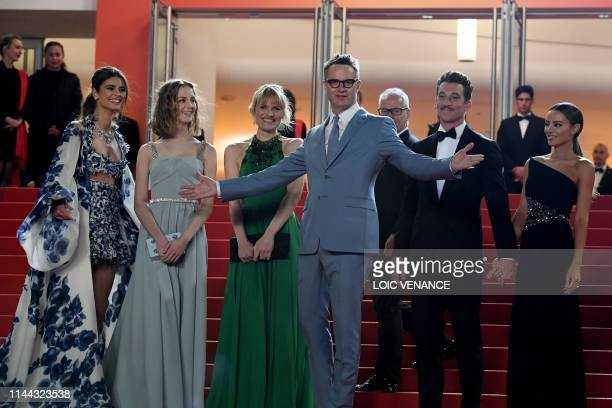 Danish director Nicolas Winding Refn poses with US model Taylor Hill his wife Liv Corfixen and daughter Lola and US actor Miles Teller and his...