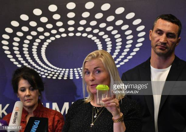 Danish doctor Gitte Pedersen explain medical tests procedure during a press conference at the Olimpiysky stadium in Kiev on April 10, 2019 as Ukraine...