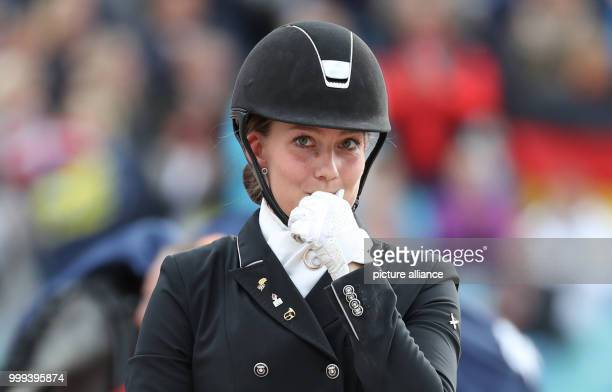 Danish dressage rider Cathrine Dufou celebrates her Bronze medal after the Special Dressage Event of the FEIEuropean Championships 2017 in...