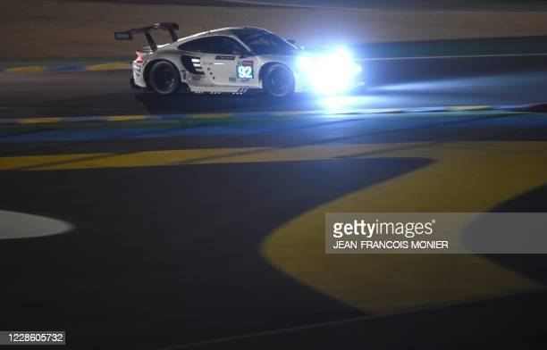 Danish driver Michael Christensen competes on his Porsche 911 RSR WEC, during the 88th edition of the Le Mans 24 Hours endurance race, at Le Mans...