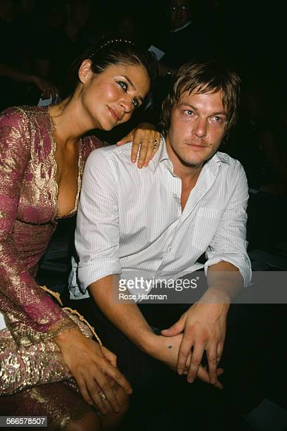 Danish fashion model and photographer Helena Christensen and American model and actor Norman Reedus attending the Marc Jacobs Spring 2003 fashion...