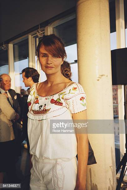 Danish fashion model Helena Christensen at a cocktail party in a Charles Street penthouse New York City 2005