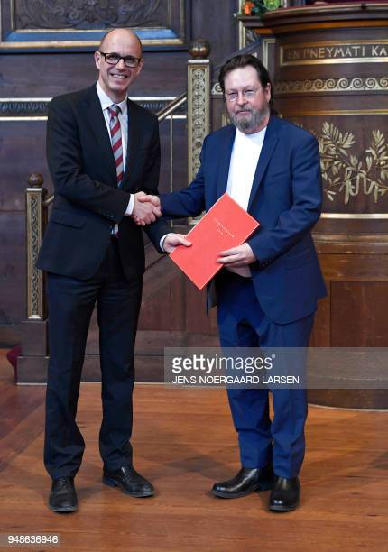 Danish Film director Lars von Trier poses for photographers next to Rector of University of Copenhagen Henrik C Wegener after receiving the Sonning...