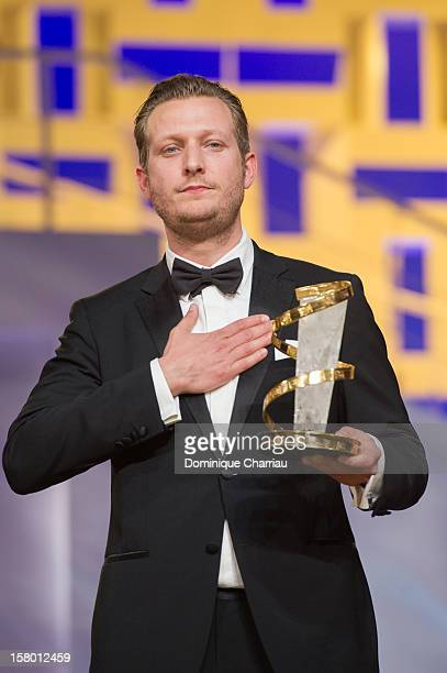 """Danish film director Tobias Lindholm poses with theJury prize for the film """"A Hijacking"""" during the award ceremony of the 12th International..."""