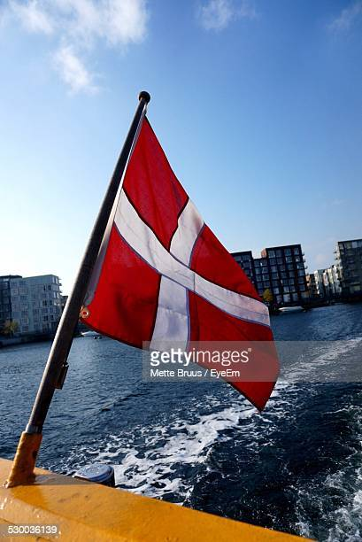 Danish Flag On Ship, City In Background