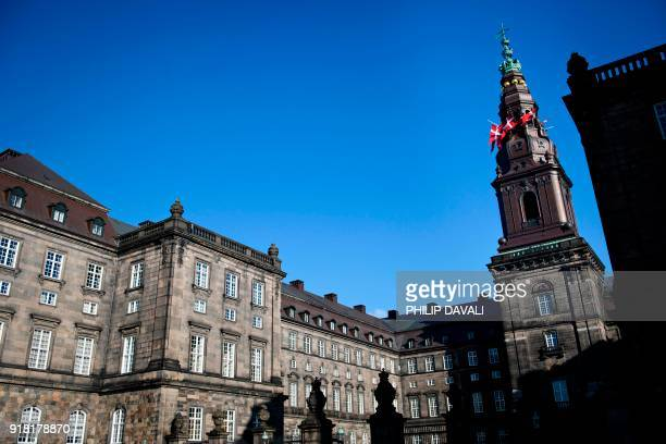 Danish flags fly at half mast on Christiansborg Palace seat of the Danish parliament in Copenhagen Denmark on February 14 after His Royal Highness...