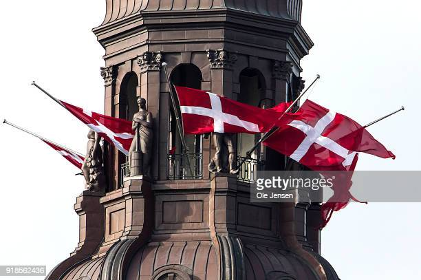 Danish flags fly at half-mast on the spire of Christiansborg in honour of Prince Henrik of Denmark who's coffin this morning was driven from...