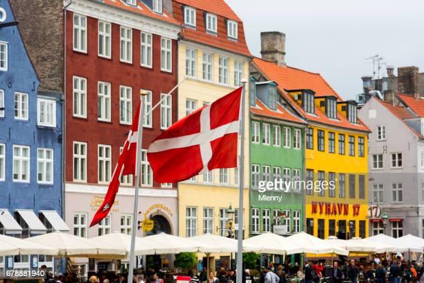 danish flags nyhavn copenhagen, denmark - nyhavn stock pictures, royalty-free photos & images