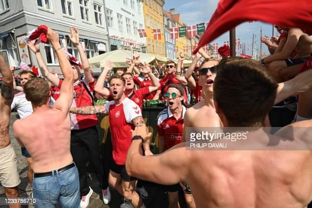 Danish football fans cheer on July 3, 2021 in Copenhagen, Denmark, prior to the Euro 2020 quarter-final match between the Czech Republic and Denmark...
