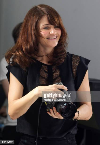 Danish Former model Helena Christensen photographs Models for 'Faconnable' s new collection Fall/Winter 20092010 on January 24 2009 in Paris France
