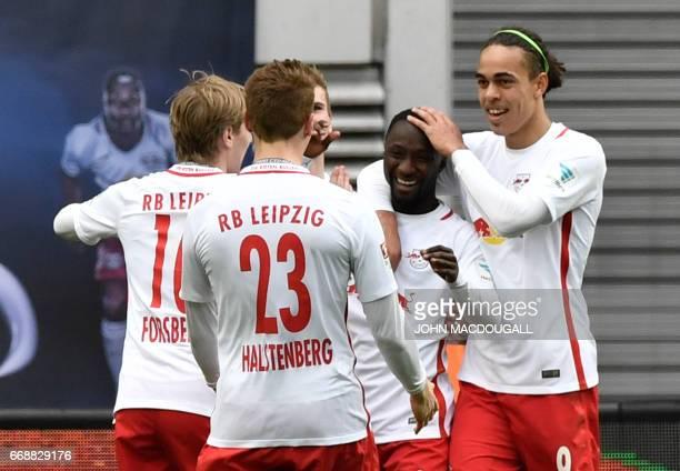 Danish forward Yussuf Poulsen celebrates with Leipzig's Guinean midfielder Naby Keita after Keita scored the third goal during the German First...