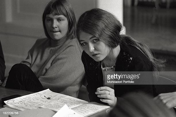 A Danish girl is smoking and taking notes during a meeting about new ethics of the Northern European countries as Denmark Copenhagen October 1969