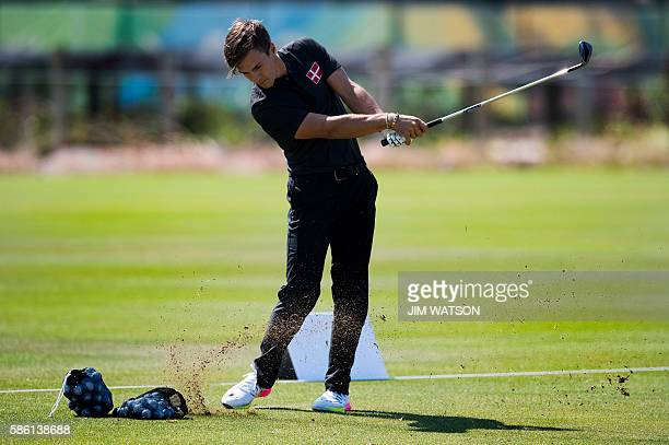Danish golfer Thorbjorn Olesen swings during a morning training session at the Rio Olympic golf course ahead of the Rio 2016 Olympic Games in Rio de...