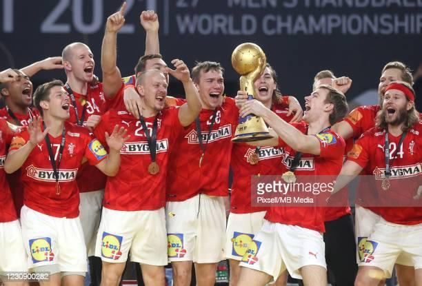 Danish handball team celebrates after winning the 27th IHF Men's World Championship final between Denmark and Sweden at Cairo Stadium Sports Hall on...