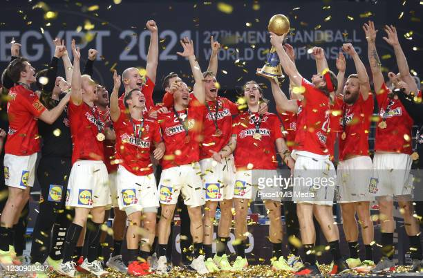 Danish handball team celebrates after winning the 27th IHF Men's World Championship final between Denmark and Sweden at Cairo Stadium Sports Hall on...