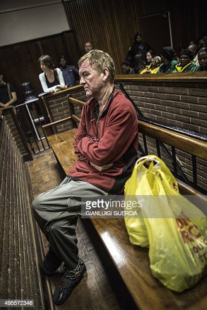Danish man living in South Africa Peter Frederiksen sits in the accused dock ahead of his bail application at the Bloemfontein Magistrate's court on...