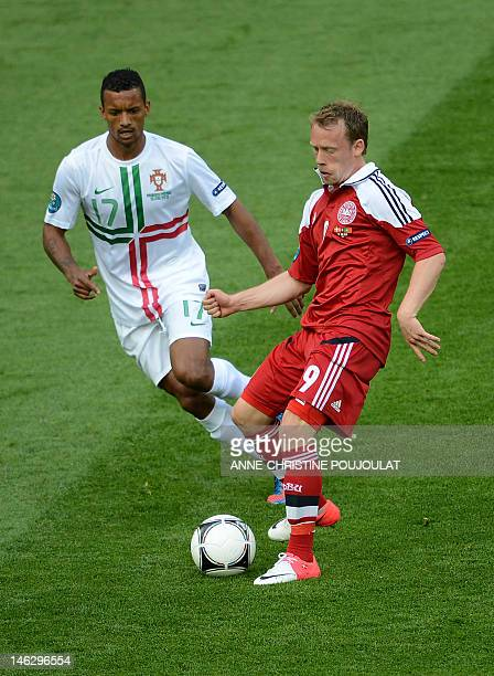 Danish midfielder Michael KrohnDehli vies with Portuguese midfielder Nani during the Euro 2012 championships football match Denmark vs Portugal on...
