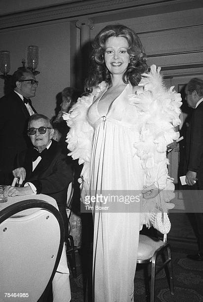 Danish model and actress Greta Thyssen smiles as she stands near American novelist short story writer and playwright Truman Capote who sits at a...