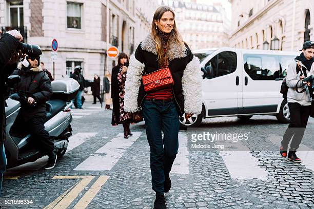 Danish model Caroline Brasch Nielsen wears a Sandy Liang coat and red Chanel bag after the Balmain show at Hotel Potocki on Day 3 of PFW FW16 on...