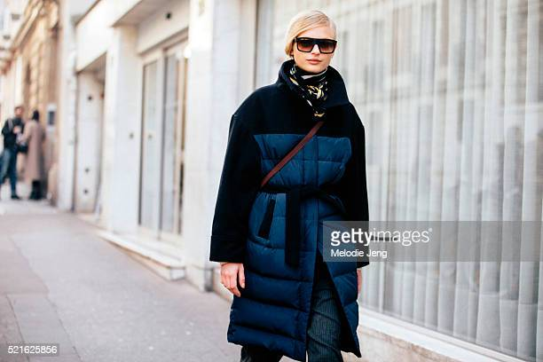 Danish model Frederikke Sofie exits the Acne Studios show at Hotel Potocki belted blue puffer coat on March 05 2016 in Paris France