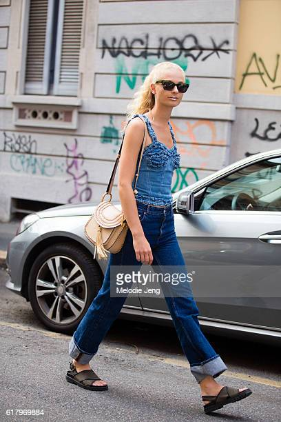 Danish model Frederikke Sofie keeps the glittery lips by Peter Philips from the Fendi show and wears black sunglasses a denim sleeveless top jeans...