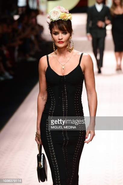 Danish model Helena Christensen presents a creation during the Dolce Gabbana fashion show as part of the Women's Spring/Summer 2019 fashion week in...