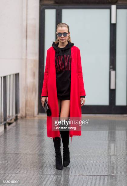 Danish model Josephine Skriver wearing a black oversized hoody as a dress red wool coat outside Mugler on March 4 2017 in Paris France