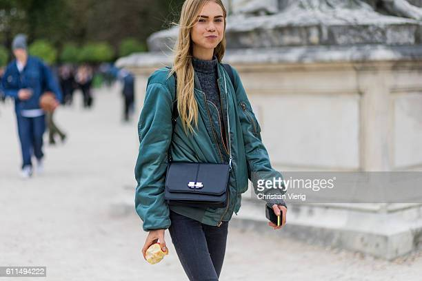 Danish model Line Brems eating an apple outside Carven on September 29 2016 in Paris France