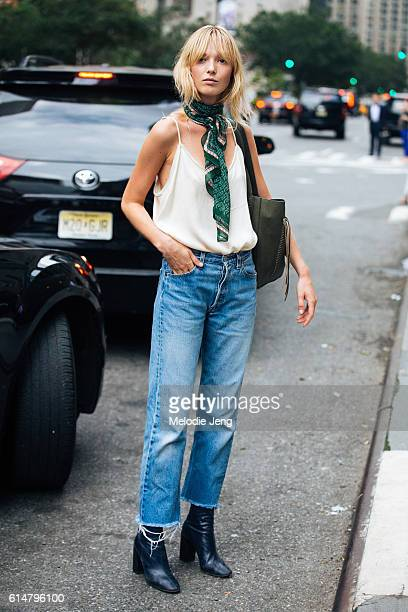 Danish model Ulrikke Hoyer wears a green scarf around her neck a white silk tank top tucked into cutoff jeans and booties after the Akris show on...