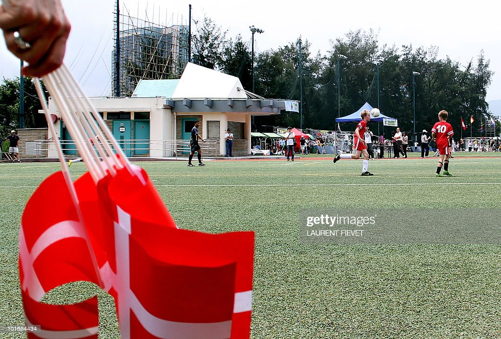 A Danish mother holds her country's flags while watching her son play football in the Mini World Cup 2010 in Hong Kong on June 6, 2010. The South Africa 2010 World Cup will start on June 11.