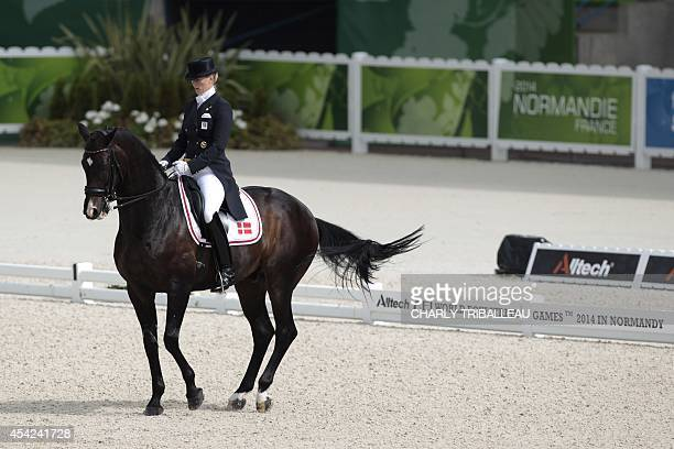 Danish Nathalie zu SaynWittgenstein rides Digby on August 27 2014 during the Individual Dressage Grand Prix of the 2014 FEI World Equestrian Games at...