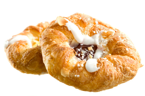 Danish pastry on white background 157290015