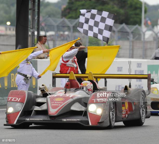 Danish pilot Tom Kristensen in his Audi R10 THI crosses the finish line during the 76th edition of the Le Mans 24 Hours endurance Race Tom Kristensen...