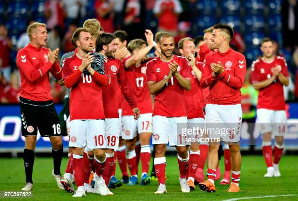 Danish players celebrate after defeating Mexico 20 in the international friendly footbal match Denmark vs Mexico in Brondby on June 9 2018 / Denmark...