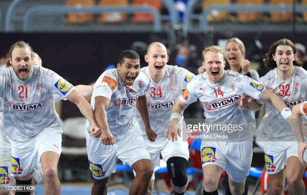 Danish players celebrate the victory after the 27th IHF Men's World Championship Quarter Final match between Denmark and Egypt at Cairo Stadium...