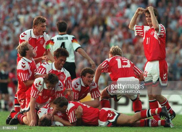 Danish players celebrate their victory after defeating Germany 20 in the Euro92 soccer championship final 26 June 1992 in Gothenburg earning their...