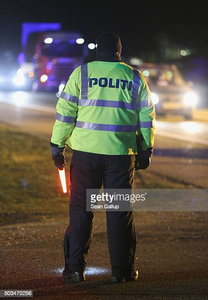 Danish police conducting spot checks on incoming traffic watch oncoming traffic arriving from Germany at the A7 highway border crossing on January 5...