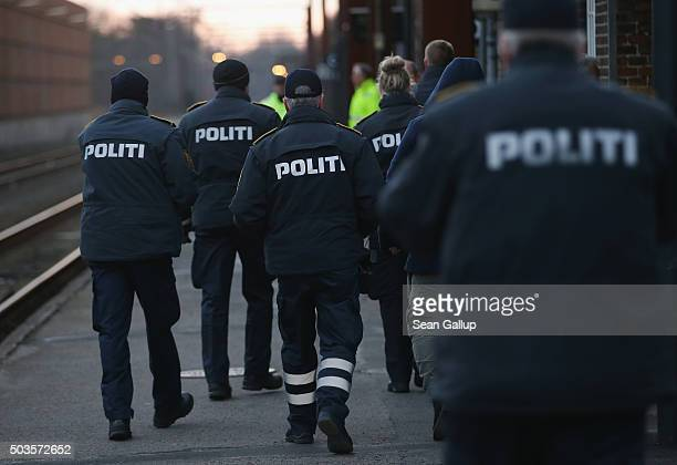 Danish police prepare to board a train arriving from Germany in order to check the identity papers of passengers on January 6 2016 in Padborg Denmark...