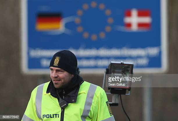 Danish policeman conducting spot checks on incoming traffic from Germany stands at a border crossing on January 6 2016 near Padborg Denmark Denmark...