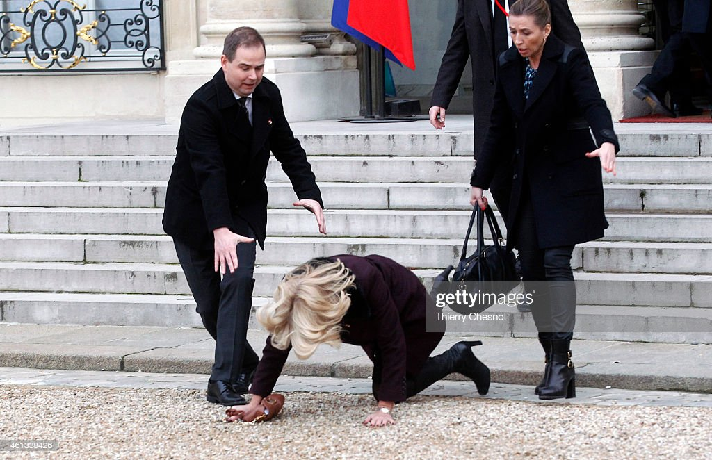 Danish Prime Minister Helle Thorning-Schmidt (C) falls down as she leaves the Elysee Palace after attending a Unity rally on January 11, 2015 in Paris, France. An estimated one million people have converged in central Paris for the Unity March joining in solidarity with the 17 victims of this week's terrorist attacks in the country. French President Francois Hollande led the march and was joined by world leaders in a sign of unity. The terrorist atrocities started on Wednesday with the attack on the French satirical magazine Charlie Hebdo, killing 12, and ended on Friday with sieges at a printing company in Dammartin en Goele and a Kosher supermarket in Paris with four hostages and three suspects being killed. A fourth suspect, Hayat Boumeddiene, 26, escaped and is wanted in connection with the murder of a policewoman.