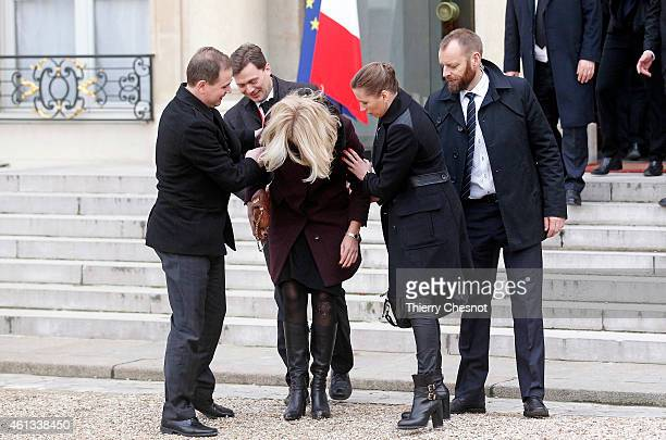 Danish Prime Minister Helle ThorningSchmidt is tended to after she fell down as she leaves the Elysee Palace after attending a Unity rally on January...