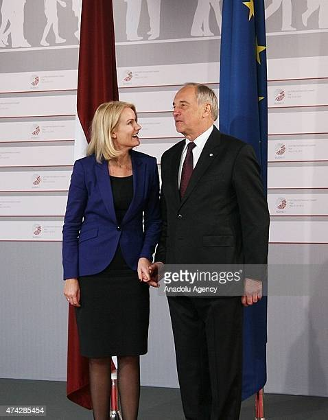 Danish Prime Minister Helle ThorningSchmidt is welcomed by Latvian President Andris Berzins as she arrives at the House of the Blackhead for a dinner...