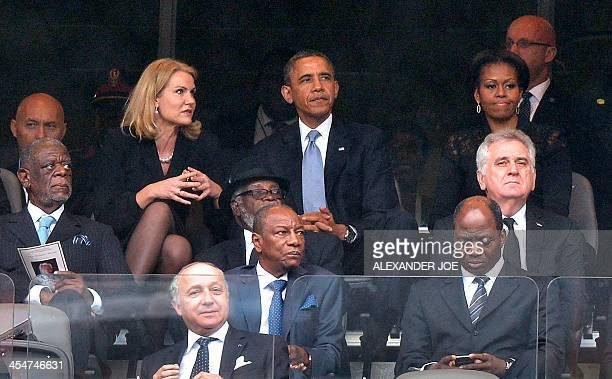 Danish Prime Minister Helle ThorningSchmidt US President Barack Obama and First Lady Michelle Obama attend the memorial service for late South...