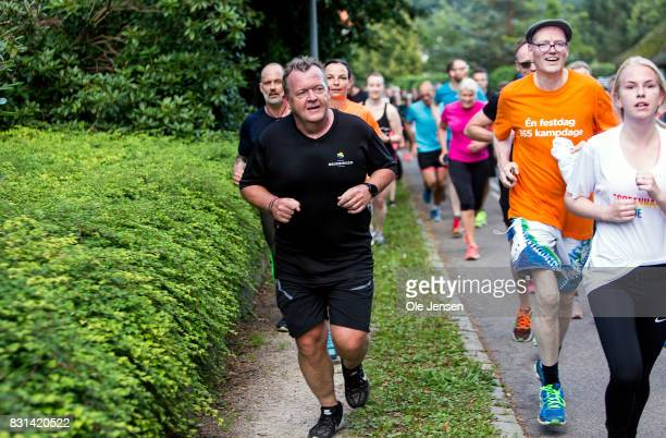 Danish Prime Minister Lars Loekke Rasmussen jogs near his official residence, Marienborg, during the 5KM running event around Lyngby Lake which he...