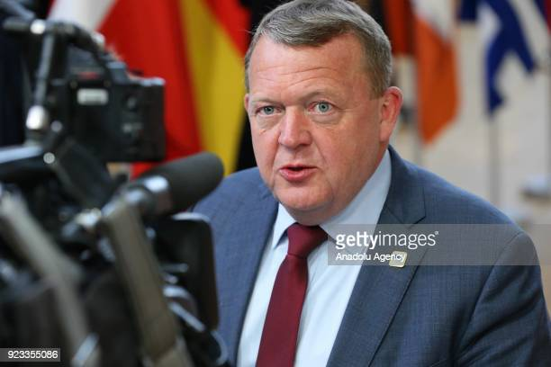 Danish Prime Minister Lars Lokke Rasmussen answers the questions of press members as he arrives to attend the EU members' informal meeting of the 27...