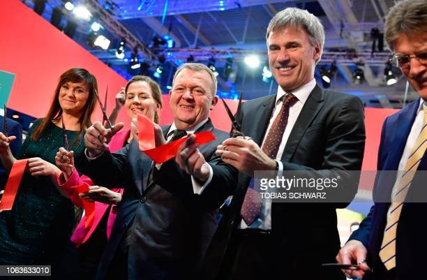 Danish Prime Minister Lars Lokke Rasmussen cuts the ribbon to open the Smart Country Convention on the digitization of public services on November...