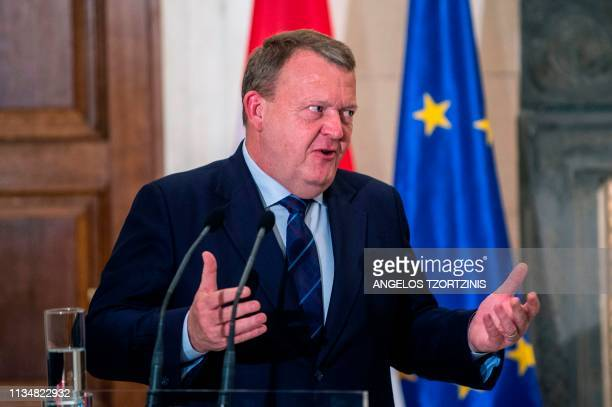Danish Prime Minister Lars Lokke Rasmussen gestures as he gives a joint press conference with his Greek counterpart, following their meeting in...
