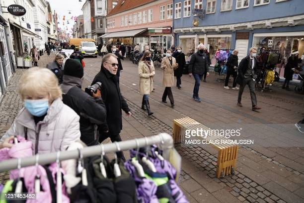 Danish Prime Minister Mette Frederiksen meets store owners who reopen their stores in Elsinore, Denmark, on March 1, 2021. - Denmark, which has been...